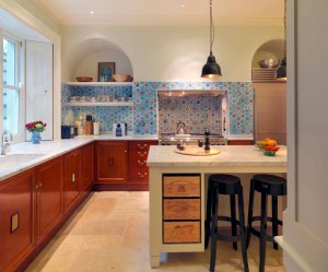 Lower units made from reclaimed specimen cabinets from the Natural History Museum with Carrara Marble worksurfaces.
