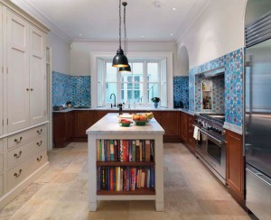 Kitchen made partly from reclaimed specimen cabinets from the Natural History Museum with Carrara Marble worksurfaces.  Hand-painted House-Keepers Cupboard and Island unit.