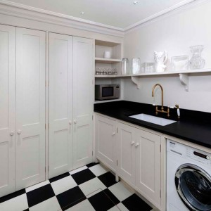 Laundry Room - Oak cabinets with hand-painted exteriors.  Welsh slate worksurface.