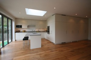 Off-white lacquered Kitchen with composite stone worktops.