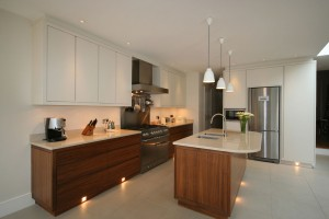 Walnut and spray-painted with stone worksurfaces.