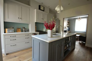 Hand-painted Kitchen in two colours.  Stone worksurface.