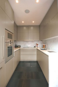 Spray-painted Kitchen with handle groove detailing.  Marble worksurfaces and splash-backs.