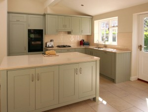 Hand-painted with composite stone worktops.