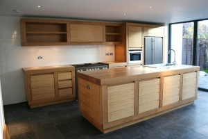 Made from solid and veneered European Oak with solid Oak worksurfaces.