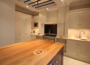 Two colour Hand-painted Kitchen with Oak interiors and stone and Oak worksurfaces.