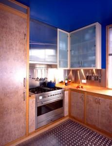 Limed Burr Oak veneered doors with European Oak carcases.  Solid Maple worktop and stainless steel splash-back.