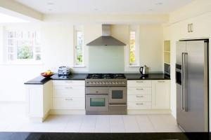 Spray-painted Kitchen with granite worktops.