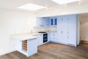 Blue hand-painted kitchen with oak interiors.