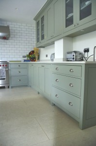 Hand-painted Kitchen with two types of stone worksurface.