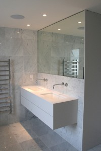 Spray-painted Vanity Unit with mitred stone top and Walnut drawers and interior.  Mirrored door cabinet recessed into wall with a white sprayed interior.