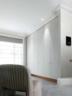 Wardrobe with an American Black Walnut interior and fabric / paper covered doors.