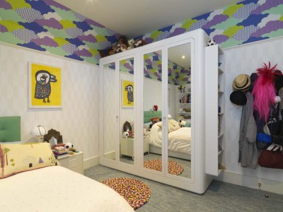 Children's Wardrobes with mirrored doors and spray-painted throughout.