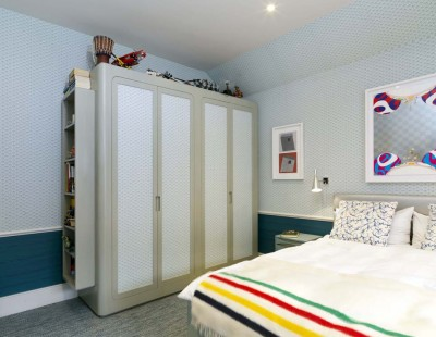 Children's Wardrobes with a spray-painted interior and hand-painted exterior.  Wall papered door centre panels.