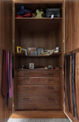 Wardrobe interior from American Black Walnut with internal drawers.