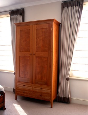 Free-standing Wardrobe made from American Cherry with Maple drawer sides and dovetail drawer construction.