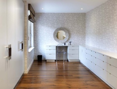Dressing Room Wardrobe and cabinets spray-painted in a satin pigmented lacquer throughout.
