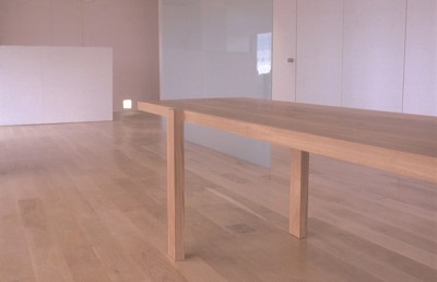 Minimal solid Oak Dining table. (with hidden structural metalwork)