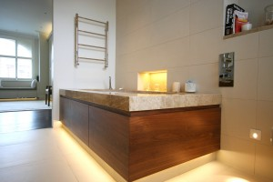 Walnut Veneered Bath Panel with integral lighting.