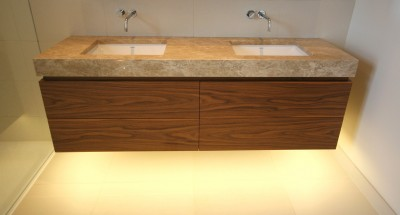 Wall-hung Walnut veneered Vanity unit with drawers and stone top.