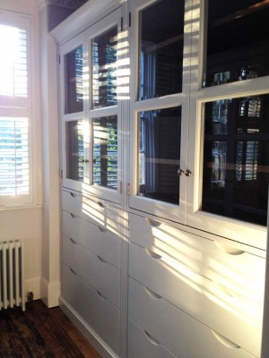Dressing Room Cabinetry made with a Walnut interior, hand-painted exterior with glazed doors.