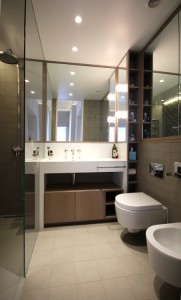 White Corian Vanity Unit with custom Corian shower tray.  Oak cabinets stained in a grey wash stain.