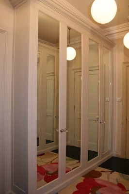 Dressing Room Wardrobes with spray-painted interiors and mirrored doors and hand-painted exteriors.