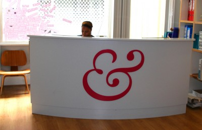 Spray-painted Reception Desk with company logo.