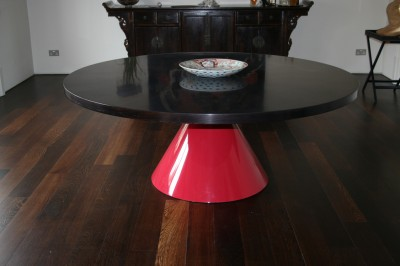 Dining Table with a stained Ash Veneered Top with converging grain pattern.  Gloss red pedestal.