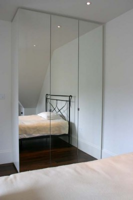 Mirrored door Wardrobes with white spray-painted interiors.