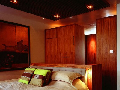 Bedroom suite made from veneered American Black Walnut throughout.  Bed with 'chest of drawers' headboard.