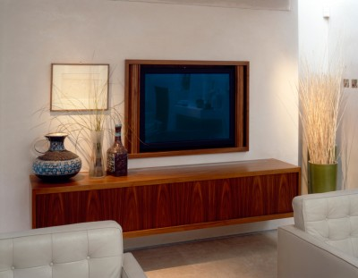 Wall hung media cabinet and television cabinet with tambour door made from Walnut.