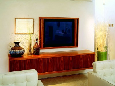 Wall hung media unit and recessed tambour fronted television cabinet made from Walnut.
