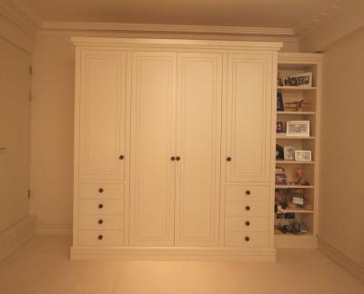Wardrobe / storage cabinet  spray-painted throughout.