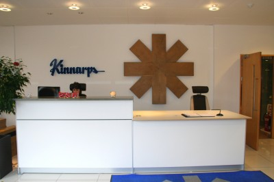 White Reception Desk with wall-hung Company logo made from Oak.