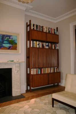 Freestanding cabinets made from American Black Walnut with television hidden behind tambour doors.