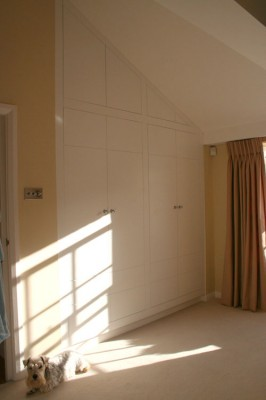 Wardrobe fitted to angled ceiling.  Spray-painted throughout.