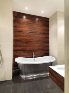 Wall-hung Washbasin unit and wall panels made from Santos Rosewood.
