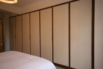 Wardrobe with a Walnut interior and exterior spray-painted with recessed handles.
