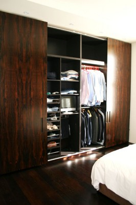 Sliding door Wardrobe with a brown spray-painted interior and Macassar Ebony veneered doors and exterior.