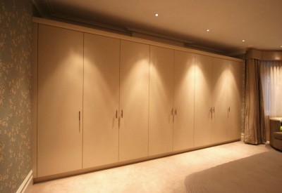 Wardrobes with spray-painted doors and Walnut interior.