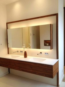 Walnut Vanity Unit with composite stone top, glass splashback and mirror door wall cabinet with lighting.