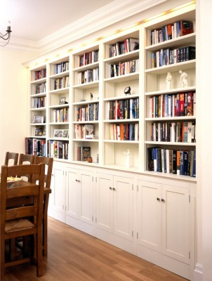 Hand-painted bookcase with integral cornice lighting.