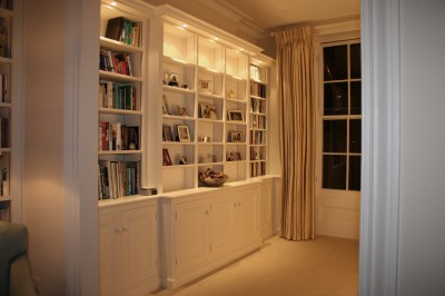 Hand-painted bookcase with lighting.