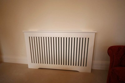Spray-painted slatted radiator cover.