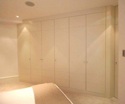 Angled Wardrobe spray-painted throughout with groove detailing on doors.