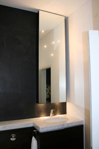 Upper and lower cabinets made from Ebony.  Mirror door with integral star lights.  Cararra marble vanity surface.