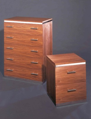 Walnut Chest of Drawers with polished steel bands.