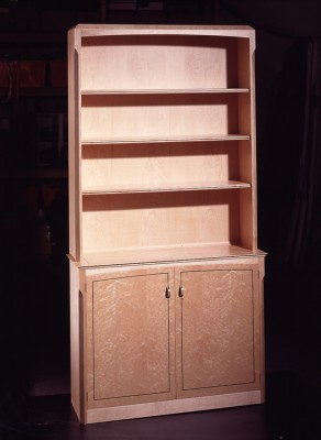 Cabinet made from Birds-eye Maple and Rosewood inlay.